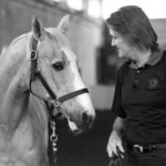 chris-standing-with-horse-bw